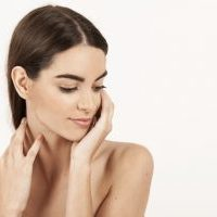 woman-with-hands-on-her-neck-and-looking-down_23-2147647715