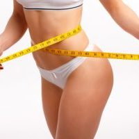 women-s-waist-with-a-tape-measure_1208-99